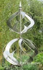 jonart wind spinner elizabethan metal garden sculpture woodside garden centre pots to inspire