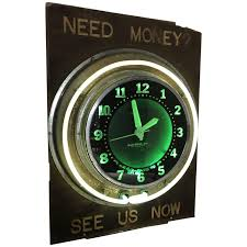 antique sign with art deco glo dial neon clock