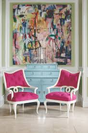 hot fuchsia and white chairs with on back and seating tufting the blue painted chest on chest cabinet is so pretty the abstract art with all the
