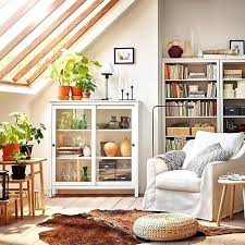 ikea living room design ideas spacious and comfortable white armchair and glass door cabinet in a
