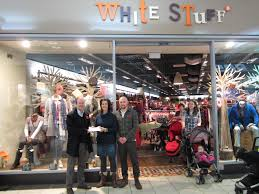 york designer outlet. peter robinson receiving cheque from white stuff designer outlet york