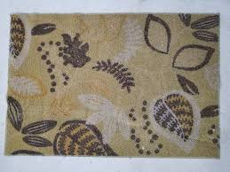green brown leaf patterned area rug 31x46in