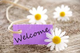 Welcome Purple A Purple Banner With Welcome On It And Flowers In The Background