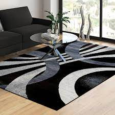 cockfosters abstract black area rug