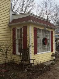 exterior paint schemes red door. new white trim work above the sun room on our big yellow house with new. red shuttersexterior colorsexterior exterior paint schemes door