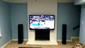 hanging tv over fireplace mounting above fireplace hiding wires mounting a above fireplace living room best