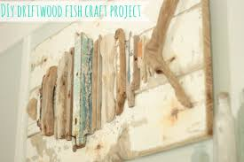 driftwood craft project on painted wood fish wall art with driftwood fish art sand and sisal