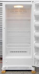 kenmore fridge inside. inside the kenmore 28432, you get three wire shelves and a sliding bucket. fridge e