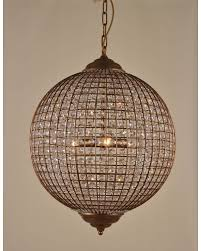 this large gold and clear crystal beaded globe pendant chandelier light is perfectly formed with its cage frame its modern and traditional mix make it