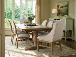 heavy wooden table small modern farmhouse dining room cream chairs pattern rugs rustic hutche wide glasswall light brown curtain desk lamp medium wood