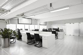 Modern office space Classy Modernofficespacewithdesks Officespace Software The Pros And Cons Of Office Layout Trends