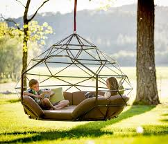 the kodoma zome as so it s called is a giant hanging hammock bed couch that you can hang from a tree branch or purchase an optional tripod to hang it from