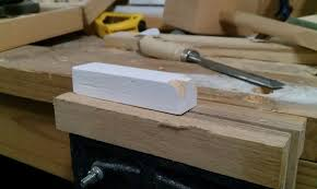 carving a wooden toy train