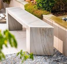natural stone garden bench in a modern