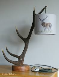 handcrafted antler lamps with handmade lampshade by grace scott
