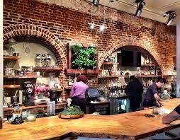 brick archways behind the live edge bar sara graham