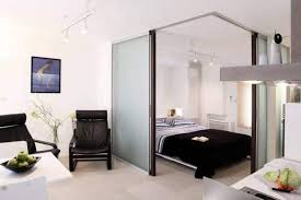 studio track lighting. Furniture , Best Studio Apartment Ideas : With Black Chairs And Bed Track Lighting