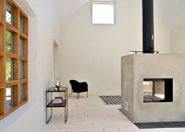 View in gallery swedish-loft-house-with-concrete-fireplace-feature-3.