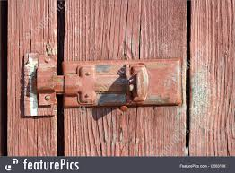 safety and security old metal locking system on a wooden door