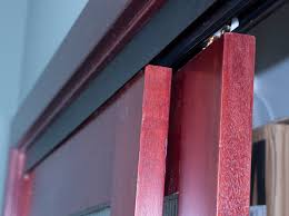 sliding bypass door hardware with bronze facia