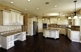 massive white kitchen with distressed wood and granite island