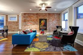 view in gallery colorful couch in blue rug and plush chairs make a vivacious living room design