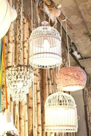 birdcage light fixtures birdcage lighting display mix it up with a chandelier a doily covered lamp birdcage light