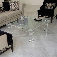 square clear acrylic furniture mixed with cream leather upholstery sofa and three soft pillows with the sweet circle patter plus black fabric upholstery acrilic furniture