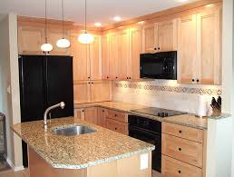Natural Maple Cabinets With Granite Countertops kitchen has light