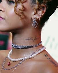 Pin By Alex On Jewels In 2019 Rihanna Neck Tattoo Rihanna La Tattoo