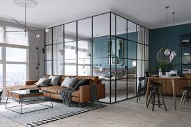 The bedroom is enclosed by glass, which helps keep the compact space light  and airy. Photos via Design Milk