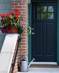like this 1950s door style to replace the exterior doors on the front and rear of the house and the side of the garage not black though