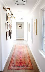 hallway natural light. narrow hallways with windows on one side are wonderful because you get the benefit of natural light colorful runner warms space and hallway e