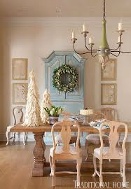 the antique dining table is from wisteria and the reion chandelier is from paul ferrante