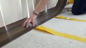 lay flat vinyl flooring laying vinyl tile vinyl plank flooring how to lay self adhesive vinyl