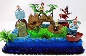 Amazoncom Peter Pan Deluxe Birthday Cake Topper Set Featuring