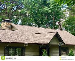 Front Of A House With New Roof Shingles Installed.