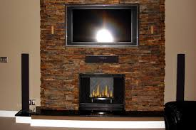 modern-mosaic-stacked-stone-fireplace-design-ideas-wood-burning-indoor- fireplace-insert-wall-mount-led-tv-fireplace-with-black-marble-base-beige-carpet-  ...