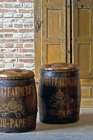 DECORATIVE WINE BARREL WITH BRANDING AND CREST DECORATION WITH A DEEP  BUTTONED LEATHER TOP AND BRASS
