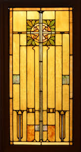 an antique american arts and crafts style stained glass panel set in zinc came the panel is very striking with gold iridized accents and a very dramatic