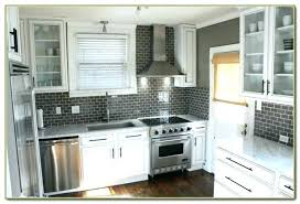 white subway tile grey grout kitchen beach with glass light tiles