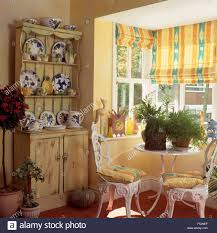 Wrought Iron Living Room Furniture Yellow Blinds On Window In A Nineties Dining Room With White