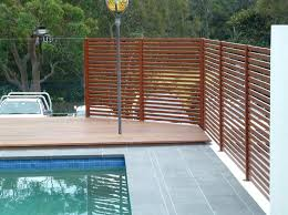 privacy screen fencing around pool with glass swimming screens