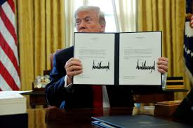 president in oval office. U.S. President Donald Trump Signs A Continuing Resolution To Keep The Government Funded And Open In Oval Office
