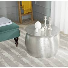organizing small living room spaces with hammered round silver metal coffee table on gray and white carpet tiles ideas