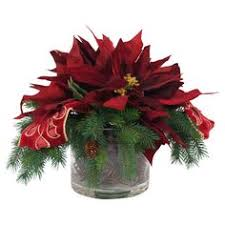 Faux poinsettia and evergreen arrangement with ribbon accents in a glass  pot. Product: Faux. Christmas Table DecorationsChristmas Arrangements Christmas ...