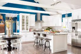 kitchen kitchen track lighting vaulted ceiling. gorgeous blue and white kitchen features three restoration hardware vintage toledo bar chairs placed in front of a island accented with gray granite track lighting vaulted ceiling