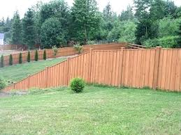 building a fence on uneven ground build a fence on a slope cedar fence on slope build vinyl fence slope ark building build a fence building wood fence on