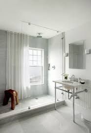 modern bathroom with seamless gl shower marble 2 leg washstand chair rail beadboard backsplash marble tilearble shower surround
