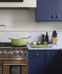 Want to make your kitchen feel less cluttered?  Consider no hardware or  hardware the same color as your cabinets.